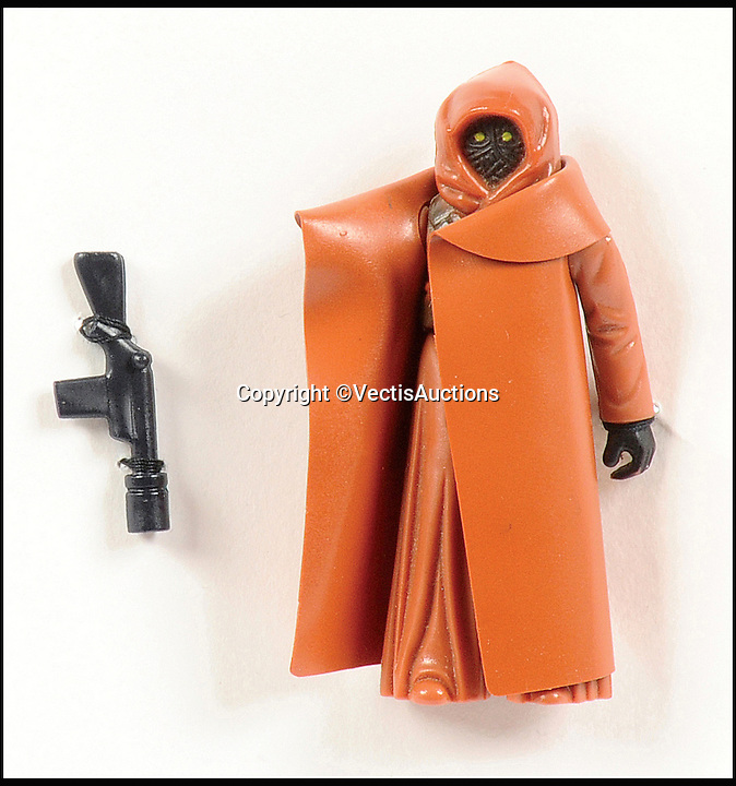 BNPS.co.uk (01202 558833)<br /> Pic: Vectis/BNPS<br /> <br /> Palitoy/Kenner Star Wars Vinyl Cape Jawa Vintage 3 3/4&quot; Loose sold for &pound;900.<br /> <br /> A tiny plastic rocket from a Star Wars action figure has sold for almost &pound;2,000 as part of a huge &pound;160,000 sale of rare toys relating to the film franchise.<br /> <br /> The red missile measures just 28mm long and was attached to the back of a prototype figure of bounty hunter Boba Fett.<br /> <br /> A complete prototype Boba Fett can sell for &pound;13,000 but thanks to a letter of authentication and grading by the Action Figure Authority (AFA), the small rocket made &pound;1,920 by itself at auction.<br /> <br /> It was one of almost 700 Star Wars lots that sold for &pound;160,000, with many toys that originally sold for &pound;1.50 achieving four-figure sums.<br /> <br /> With the release of Star Wars:The Force Awakens imminent, interest in memorabilia from the franchise has never been higher.