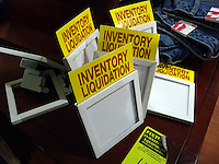 Inventory liquidation signs at a Steve & Barry's clothing store in New York on Saturday, January 3, 2009. The chain is shutting all 173 stores and liquidating approximately $250 million worth of merchandise. (© Richard B. Levine)