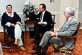 United States President Ronald Reagan, left, jokes with Vice President George H.W. Bush, center, and White House Chief of Staff Donald Regan, right, during their meeting at Bethesda Naval Medical Center on Wednesday, July 17, 1985..Mandatory Credit: Pete Souza - White House via CNP