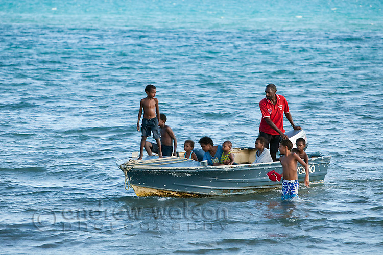 Family travelling by dinghy - the main mode of transport between the islands of the Torres Strait.  Thursday Island, Torres Strait Islands, Queensland, Australia
