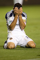 Landon Donovan grimaces with his hands to his face after narrowly missing a goal. FC Dallas defeated the LA Galaxy 3-0 to win the Western Division 2010 MLS Championship at Home Depot Center stadium in Carson, California on Sunday November 14, 2010.