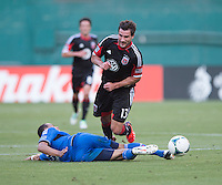 Chris Pontius (13) of D.C. United is fouled by Jason Hernandez (21) of the San Jose Earthquakes during a Major League Soccer game at RFK Stadium in Washington, DC.  D.C. United defeated San Jose Earthquakes, 1-0.