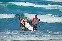 """Coolangatta, Queensland, Australia (Sunday February 13th 2011): Owen Wright (AUS and Joel Parkinson (AUS).   SNAPPER SURFRIDERS CLUB have confirmed their status as Australia's premier boardriding club by winning the 2011 Rhythm Kirra Teams Challenge in excellent 1m (3feet) surf at Duranbah Beach on the southern Gold Coast..It was Snapper's 9th win of this prestigious title, placing them well ahead of their closest rival Kirra who placed second..Today's victory was typical of this event, getting down to the very last surfer of their 8 man team to bring the victory home in a nail biting finish..Clint Kimmins was the Snapper surfer with all the pressure placed on him as the final surfer. The equation was simple, win the heat and win the title for Snapper, lose and the title would be won by either Merewether (NSW) or Kirra (Qld)... It was a see-sawing duel between Kimmins and Palm Beach Boardriders surfer Jeff Norris with multiple changes in the lead but in the end Kimmins won by just 0.23 of a point..""""That was the toughest heat I've surfed"""" said a relieved Kimmins after the heat.."""" Surfing for the team, I knew the situation and I just tried to concentrate on surfing my best but the pressure was there - knowing Parko and Deano and the whole rest of the team had done their job to get us to a winning position - it was tough but it feels great now - we're number one club!"""".Snapper's win was incredible as they started the event with 3 consecutive 2nd placings in their 8 surfer team and many thought they were gone in the early stages..However, their final 5 surfers brought home 5 consecutive wins and they stole the title..Their team and heat placing were as follows - Blake Ainsworth (2nd), Mitch Crews (2nd),  Jay Phillips (2nd), Ice Periera-Ryan (1st), Shaun Gossman (1st), Joel Parkinson (1st), Dean Morrison (1st) and Clint Kimmins (1st)... A number of outstanding ASP World Tour and former world tour surfers competed for the pride of their club today, lead by former two time"""