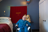 Margaret Rouleau, 84, sits in her bedroom in her residence at Malone Park at the Fernald Center in Waltham, Massachusetts, USA.  Margaret is one of the few residents who can speak.