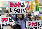 """Mone Shimane, 5, holds up a sign reading """"we don't need nuclear power"""" as around 4,000 people take part in a demonstration  in Tokyo, Japan on  10 April 20011. .Photographer: Robert Gilhooly"""