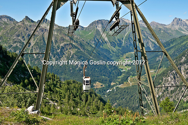 View of the Bregaglia Valley in Switzerland and the cable car that takes you to the Albigna dam, one of over 150 dams in the country; The Albigna dam sits at 2,163 meters elevation