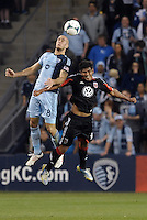 Aurelien Collin (78) defender Sporting KC  wins the aerial battle with Rafael (9 ) forward D.C Utd ..Sporting Kansas City defeated D.C Utd 1-0 at Sporting Park, Kansas City, Kansas.