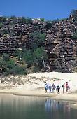 Travelers exploring shore at Tranqulity Bay, Kimberley, AUSTRALIA