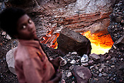 The burning coal mine is seen  village Borapahari in Jharia, Jharkhand, India. Coal fires rage just below the surface of the ground, making it too hot to walk with naked feet, noxious gases spew up from fissures, making the environment toxic. Residents who live above the furnace make $2 a day collecting small chunks of coal they sell to illegal middlemen. One or two houses collapse annually into vast underground caverns left unfilled by abandoned mining operations. Photo: Sanjit Das