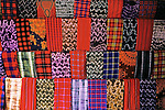 Africa, Kenya, Maasai Mara. A colorful display of fabrics and cloth of the Maasai people at Olanana in the Maasai Mara.