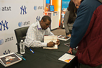 "Former New York Yankee and New York Mets pitcher Dwight ""Doc"" Gooden greets fans and signs autographs at the grand opening ceremony of a new AT&T store in the Queens Center Mall in the New York borough of Queens on Saturday, February 25, 2012.  The new store is bilingual catering to the ethnically diverse population of Queens with signs in Spanish and English and Spanish speaking staff on hand. (© Richard b. Levine)"