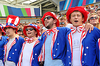 USA supporters in the crowd sing the national anthem. Rugby World Cup Pool B match between Samoa and the USA on September 20, 2015 at the Brighton Community Stadium in Brighton, England. Photo by: Patrick Khachfe / Onside Images