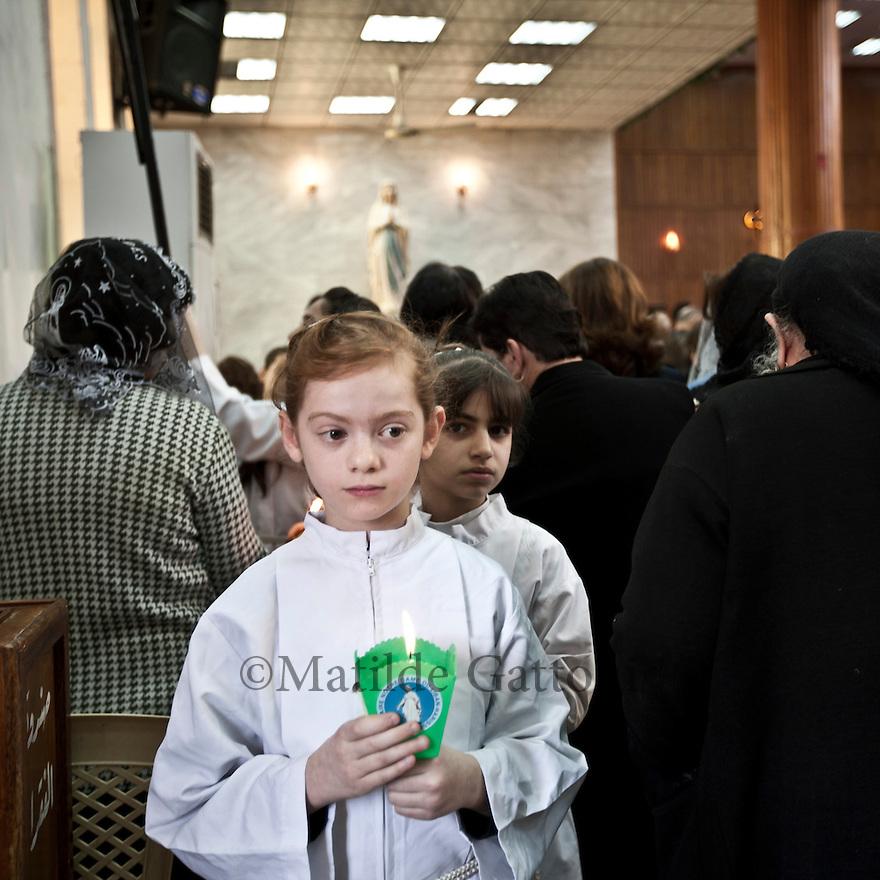 Iraq - Kurdistan - Ankawa - Little girls walking through Christian women praying inside St Joseph Cathedral.