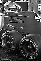 Jody Scheckter waits to drive the Tyrrell P34 six-wheel Formula 1 car during practice for the 1976 Grand Prix of Sweden at Anderstorp.