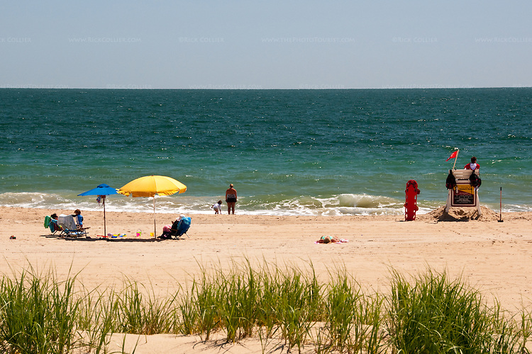 Early season visitors enjoy a sparsely-populated beach on one of the first warm days of the season at Rehoboth Beach, Delaware, USA.