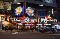 Restaurants along 42nd street in Times Square in New York including a Famous Dave's BBQ restaurant and a Dave and Buster's restaurant sharing a space and an Applebee's. seen on Thursday, December 29, 2011. (© Richard B. Levine)