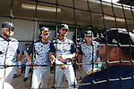 31 May 2016: Nova Southeastern's Brandon Gomez (24), Andrew Liberty, Sebastian Diaz (12) and Kavan Thompson (2) listen to assistant coach Eric Cruz (foreground, right). The Nova Southeastern University Sharks played the Lander University Bearcats in Game 8 of the 2016 NCAA Division II College World Series  at Coleman Field at the USA Baseball National Training Complex in Cary, North Carolina. Nova Southeastern won the game 12-1.