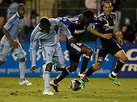 Simon Dawkins of Earthquakes controls the ball away from C.J. Sapong of Kansas City during the game at Buck Shaw Stadium in Santa Clara. California on October 1st, 2011.  San Jose Earthquakes tied Sporting Kansas City, 1-1.