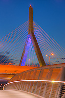 The sky begins to lighten during morning twilight behind one of the suspension towers of the Leonard P. Zakim Bunker Hill Memorial Bridge.  The bridge carries I-93 and US Route 1 traffic over the Charles River in Boston, Massachusetts.