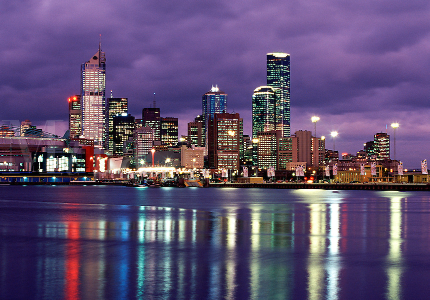 Twilight view of skyline with new stadium across Yarra River, Melbourne, Australia