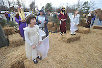NWA Media/Michael Woods --12/21/2014-- w @NWAMICHAELW...Angels, played by Leighann Talbert age 5 (left) and Kamy Strauss, age 8, sing as visitors walk through the living nativity at the Bella Vista Christian Church Sunday evening in Bella Vista.  It is the second year for the church to offer the live nativity to the community, with a new feature of  live camels for this years display.