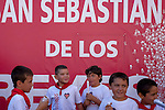Children stands after the first bull run of the San Sebastian de los Reyes Festival near Madrid, on August 26, 2014. © Pedro ARMESTRE