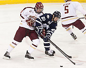 Destry Straight (BC - 17), Kevin Goumas (UNH - 27) - The Boston College Eagles and University of New Hampshire Wildcats tied 4-4 on Sunday, February 17, 2013, at Kelley Rink in Conte Forum in Chestnut Hill, Massachusetts.