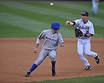 Ole Miss second baseman Alex Yarbrough (2) chases Memphis' Jacob Wilson (9) in a rundown at Oxford-University Stadium in Oxford, Miss. on Tuesday, February 28, 2012. Ole Miss won 7-2.