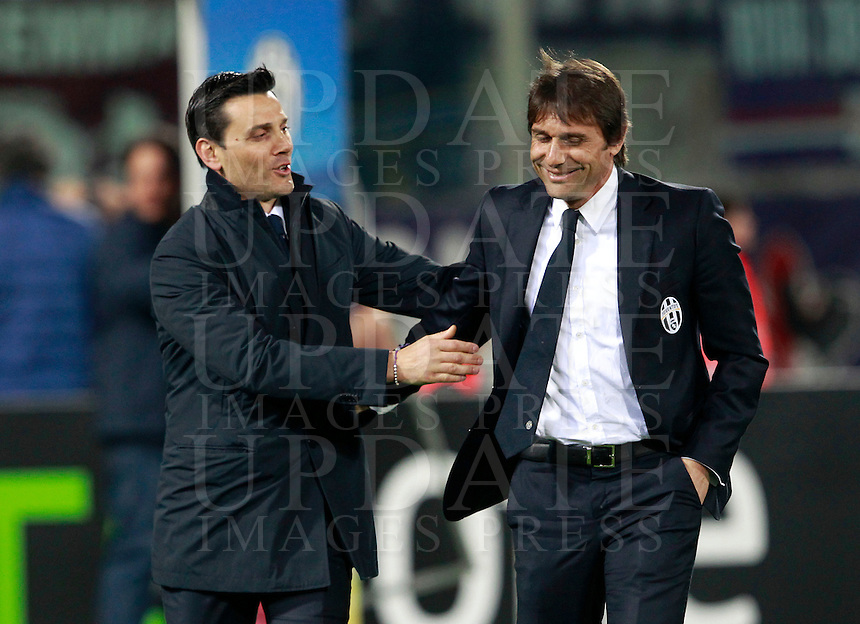 Calcio, ritorno degli ottavi di finale di Europa League: Fiorentina vs Juventus. Firenze, stadio Artemio Franchi, 20 marzo 2014. <br /> Fiorentina coach Vincenzo Montella greets Juventus coach Antonio Conte, right, prior to the start of the Europa League round of 16 second leg football match between Fiorentina and Juventus at Florence's Artemio Franchi stadium, 20 March 2014. Juventus won 1-0 to advance to the round of eight.<br /> UPDATE IMAGES PRESS/Isabella Bonotto