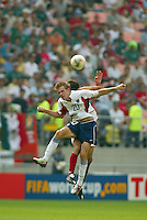 Brian McBride battles for a header. The USA defeated Mexico 2-0 in the Round of 16 of the FIFA World Cup 2002 in South Korea on June 17, 2002.