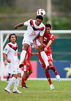 Jordan Hamilton (15) of Canada goes up for a header with Bryan Santamaria (17) of Panama during the semifinals of the CONCACAF Men's Under 17 Championship at Catherine Hall Stadium in Montego Bay, Jamaica. Canada defeated Panama, 1-0.