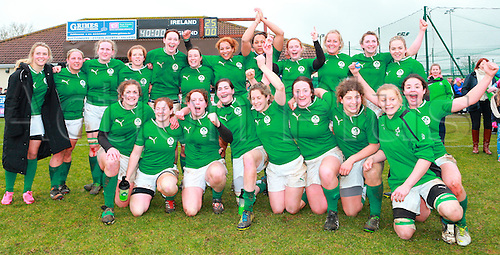 09.02.2013. Ashbourne RFC, Ireland. International Rugby Ireland Women versus England Women - Ashbourne RFC. The Irish team celebrate and pose in front of the scoreboard.