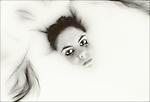 Girl submerged in bath of milk