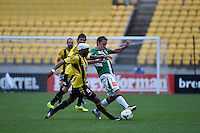 Rolieny Bonevacia Scott Neville in action during the A League - Wellington Phoenix v Newcastle Jets Game at Westpac Stadium, Wellington, New Zealand on Sunday 26 October 2014. <br /> Photo by Masanori Udagawa. <br /> www.photowellington.photoshelter.com.