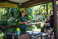 People in conversation at the entrance to the Hawai'i Tropical Botanical Garden in Onomea, north of Hilo, on the BigIisland of Hawaiʻi.