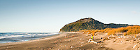 Young woman on Three Mile beach near Okarito, West Coast, Westland Tai Poutini National Park, UNESCO World Heritage Area, New Zealand, NZ
