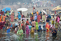 Hindu pilgrims gather at the banks of the Ganges river at the holy city of Varanasi, also known as Benares...Photo: Tom Pietrasik.Varanasi, Uttar Pradesh, India.February 2008