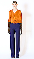 Model wears a cascade lapel blouse and flared leg trousers by Fiona Cibani, for the Ports 1961 Pre-Fall 2011 L'heure bleue collection, December 8, 2010.