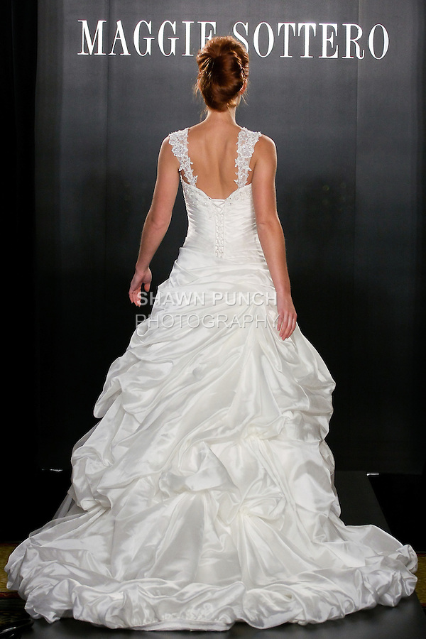 Model walks the runway in a Kitt Couture wedding dress from the Maggie Sottero Bridal Spring 2012 collection, during  Couture: New York Bridal Fashion Week 2012