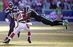Seattle Seahawks strong safety Kam Chancellor (31) goes airborne to tackle  Arizona Cardinals running back Andre Ellington (38) as  cornerback Byron Maxwell (41) provides backup at CenturyLink Field in Seattle, Washington on November 23, 2014. The Seahawks beat the Cardinals 19-3.   ©2014. Jim Bryant Photo. All Rights Reserved.