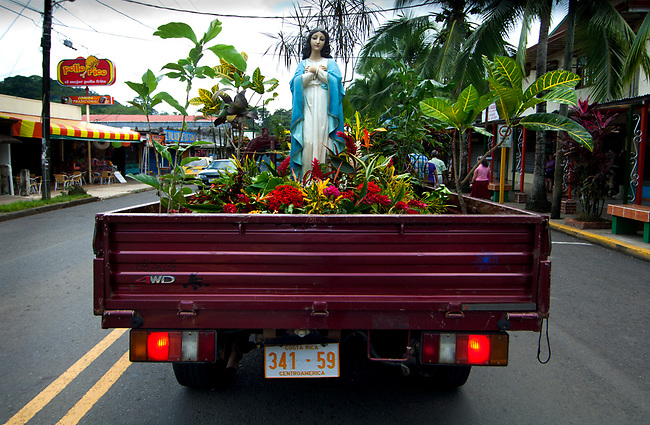 Statue of the Virgin Mary on parade during a religious festival honoring the end of the month of August.