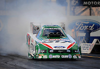 Jan 23, 2010; Chandler, AZ, USA; NHRA funny car driver Ashley Force Hood does a burnout during testing at the National Time Trials at Firebird International Raceway. Mandatory Credit: Mark J. Rebilas-