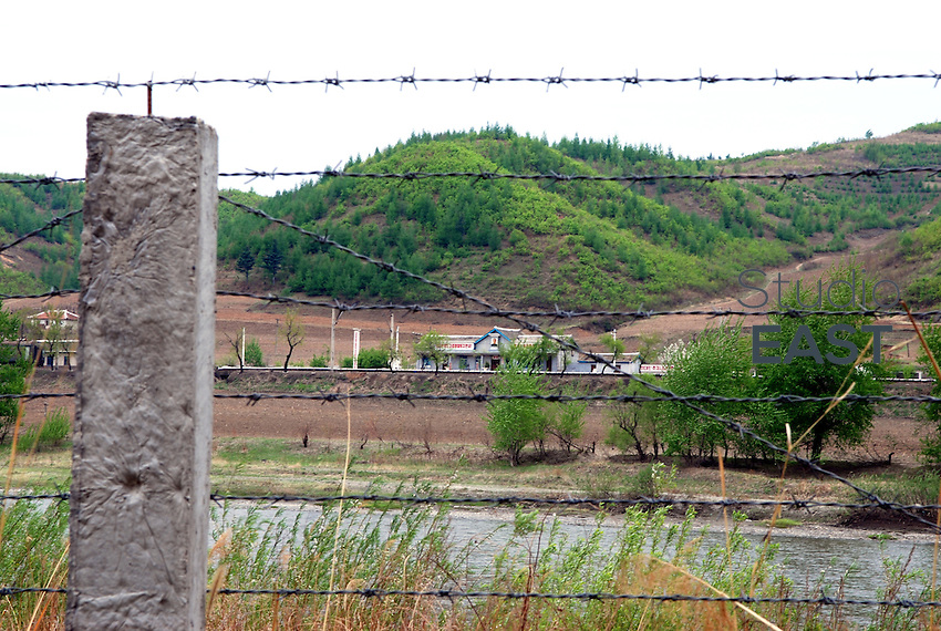 A North Korean trainstation is seen through barbed wire on the Chinese side, from a location near Kaishantun, Jilin province, China, on May 10, 2009. This is the closest one can get to North Korea from China. Photo by Juha-Pekka Kervinen/Pictobank