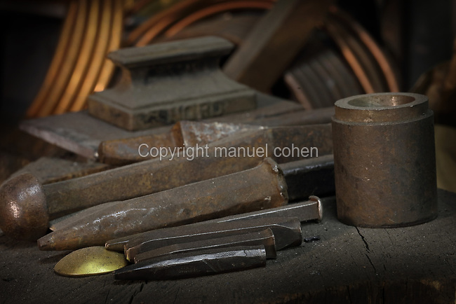Metalworking tools in the Soleil Rouge workshop of Nicolas Desbons, metalworker and artist, photographed in 2017, in Montreuil, a suburb of Paris, France. Desbons works mainly in steel but often in conjunction with other materials such as fibreglass, glass and clay, using both cold metal and forge techniques. He produces both figurative and abstract sculptures as well as furniture and lighting. Picture by Manuel Cohen