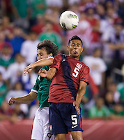 Michael Orozco Fiscal (5) of the USMNT goes up for a header with Omar Arellano (9) of Mexico during the game at Lincoln Financial Field in Philadelphia, PA. The USMNT tied Mexico, 1-1.