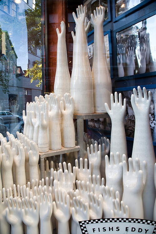 Porcelain moulds of hands and fingers formerly used to mass produce latex gloves are on display in Fishs Eddie chinaware shop on Broadway NYC USA