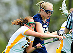 1 May 2010: University of New Hampshire Wildcat defender Ally Stager, a Freshman from Reading, MA, in action against University of Vermont Catamount midfielder Alison Haigh, a Senior from Northborough, MA, at Moulton Winder Field in Burlington, Vermont. The visiting Wildcats defeated the Lady Catamounts 18-10 in the last game of the 2010 regular season. Mandatory Photo Credit: Ed Wolfstein Photo