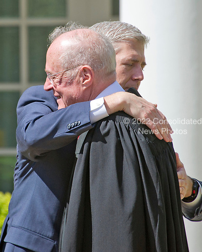 Associate Justice of the United States Supreme Court Neil Gorsuch, right, hugs his former mentor, Associate Justice Anthony Kennedy, left, following the Oath of Office ceremony in the Rose Garden of the White House in Washington, DC on Monday, April 10, 2017.<br /> Credit: Ron Sachs / CNP<br /> (RESTRICTION: NO New York or New Jersey Newspapers or newspapers within a 75 mile radius of New York City)
