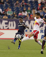 New England Revolution midfielder Joseph Niouky (23) passes the ball as New York Red Bulls forward Juan Pablo Angel (9) defends. The New England Revolution defeated the New York Red Bulls, 3-2, at Gillette Stadium on May 29, 2010.