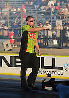 Sept. 23, 2011; Ennis, TX, USA: NHRA crew member for top fuel dragster driver Terry McMillen helps back him up during qualifying for the Fall Nationals at the Texas Motorplex. Mandatory Credit: Mark J. Rebilas-